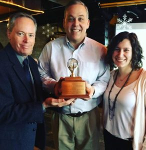 Syracuse Winter campaign team members pose with the coveted golden snowball award