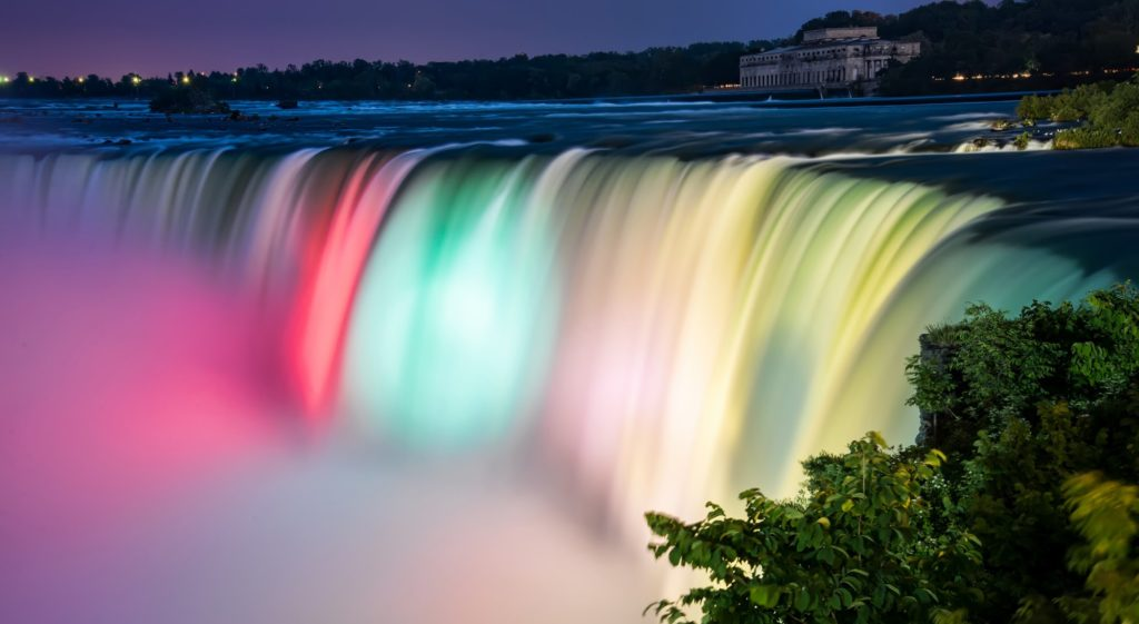 Niagara Falls lit up with rainbow colors