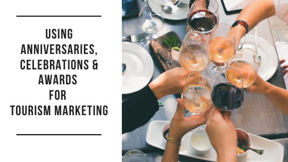 Using Anniversaries, Celebrations and Awards for Tourism Marketing [image of several people with wine glasses bringing them together to cheers]